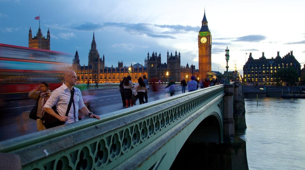 Big Ben showing a bridge, a city and a river or creek