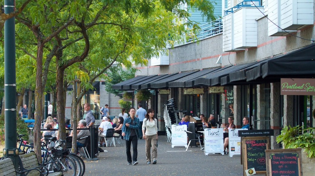 Tom McCall Waterfront Park showing street scenes, shopping and a city