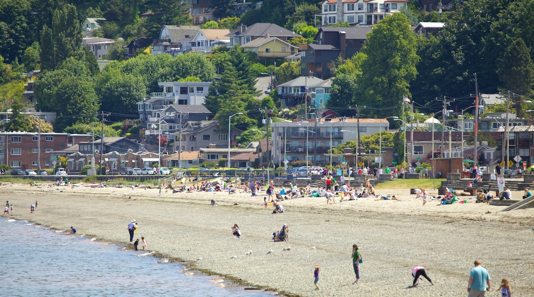 Alki Beach showing a sandy beach and a city