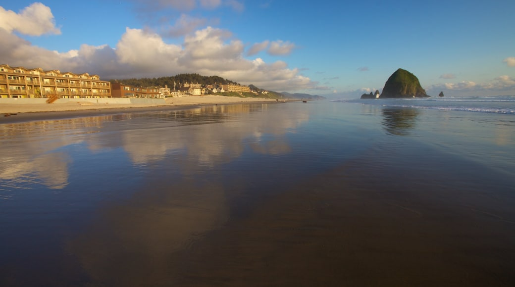 Cannon Beach featuring a beach, a coastal town and landscape views