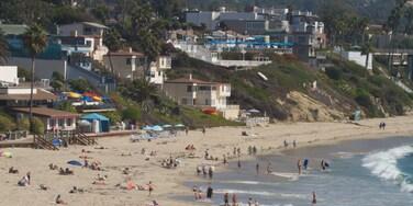 Laguna Beach showing landscape views, a sandy beach and a coastal town