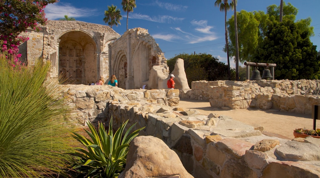 Mission San Juan Capistrano which includes heritage architecture and landscape views