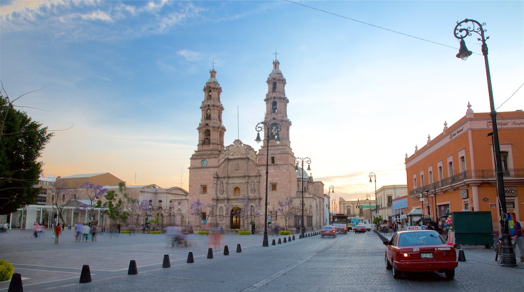 El Bajio which includes a church or cathedral, a sunset and heritage architecture