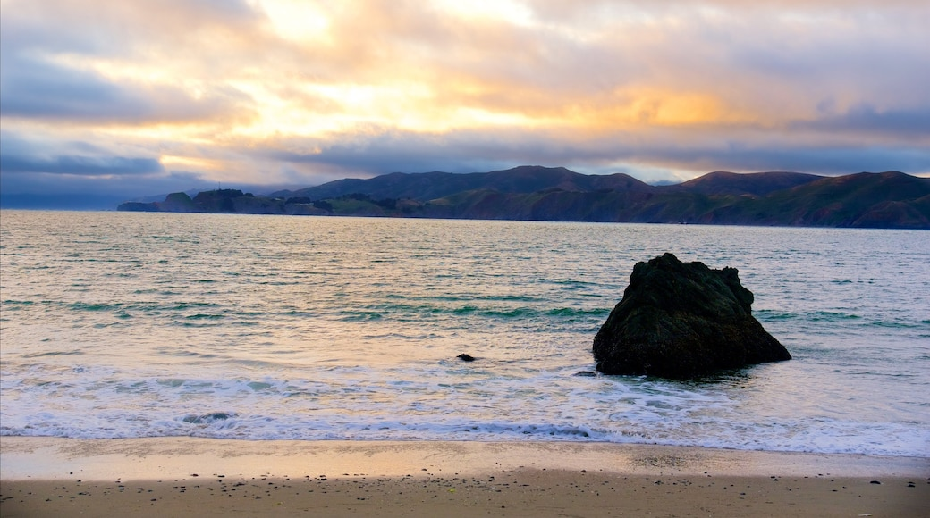 China Beach which includes a sunset and a sandy beach