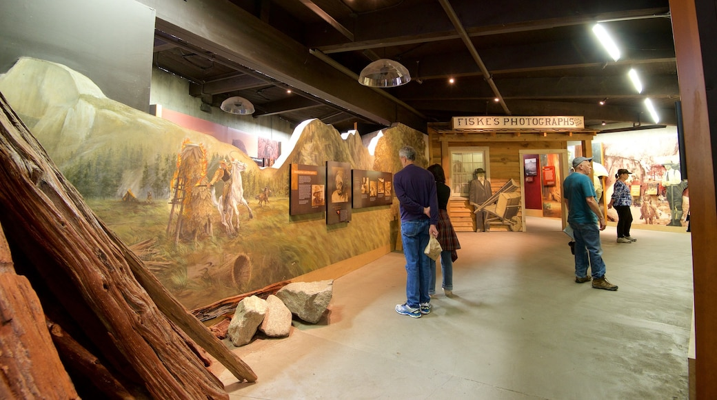 Yosemite Visitor Center featuring interior views as well as a large group of people