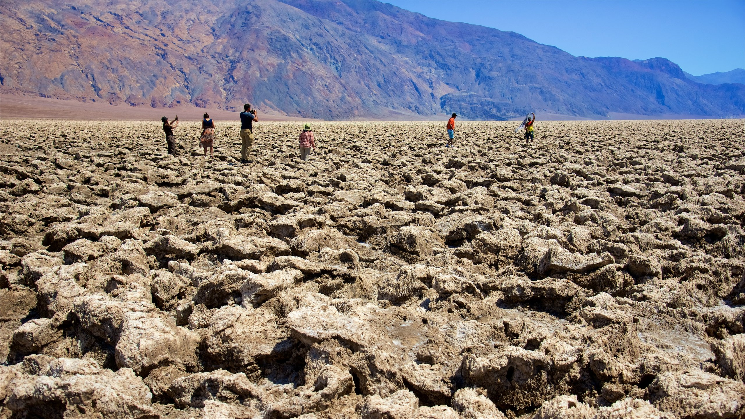 Clamber over the serrated surface of this enormous saltpan in Death Valley, where huge halite salt crystals have sculpted the bottom of a former lake.