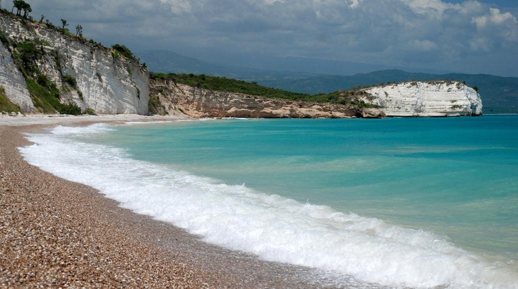 Haiti which includes a pebble beach and rocky coastline