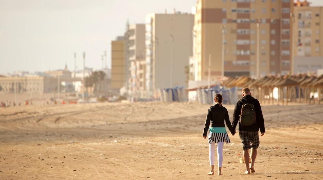 Victoria Strand das einen Wandern oder Spazieren und Strand sowie Paar