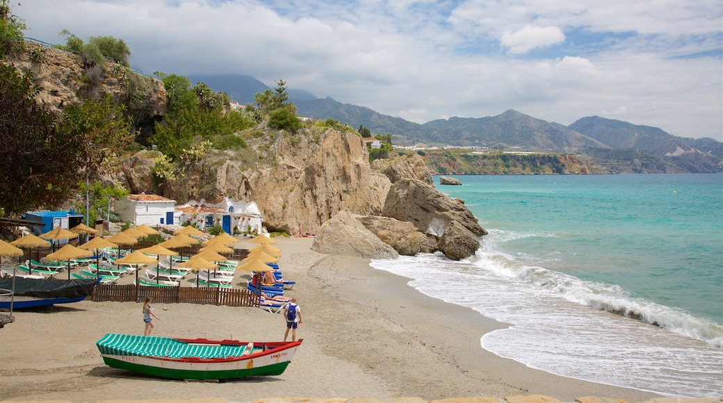 Nerja which includes a sandy beach, boating and general coastal views