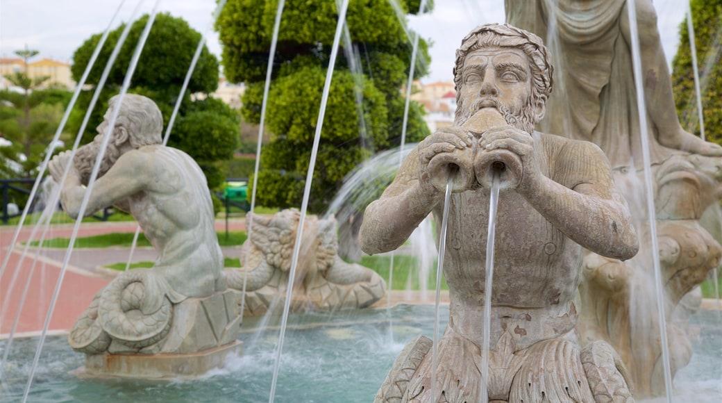 La Bateria som visar en staty eller skulptur och en fontän