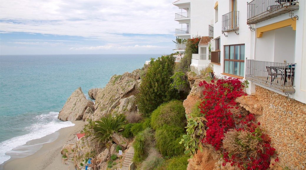 Nerja which includes a coastal town, general coastal views and a sandy beach