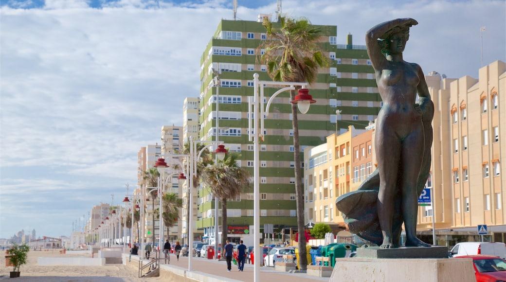 Victoria Strand mit einem Küstenort und Statue oder Skulptur