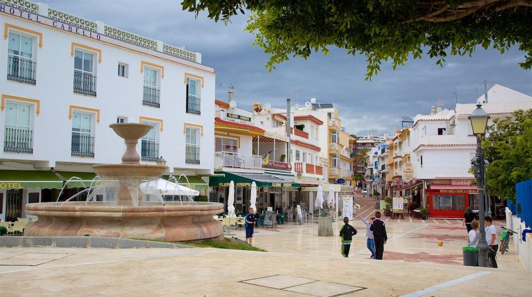La Carihuela que incluye una fuente y escenas urbanas