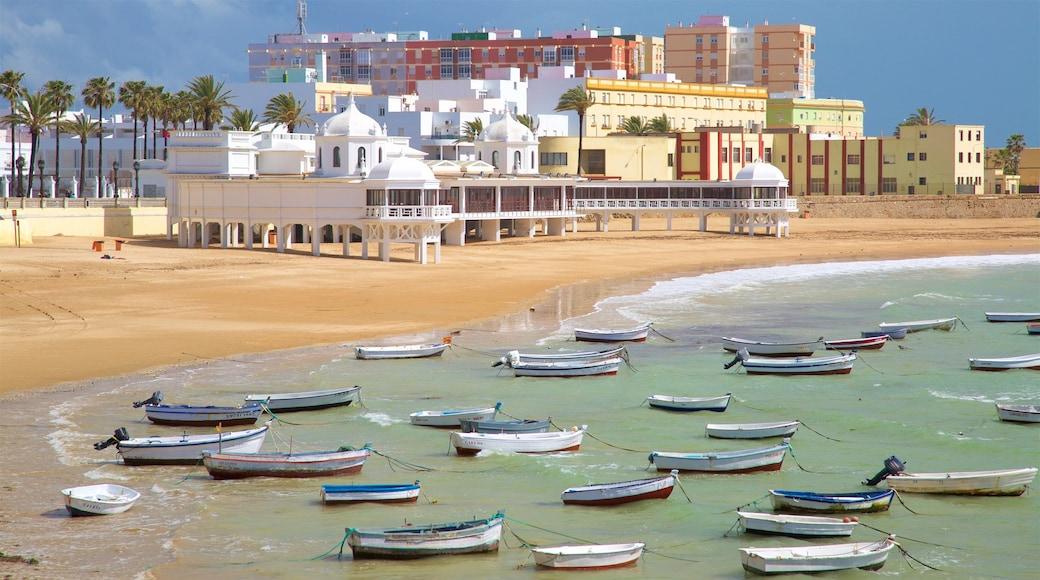 La Caleta Strand mit einem Sandstrand, Bootfahren und Bucht oder Hafen