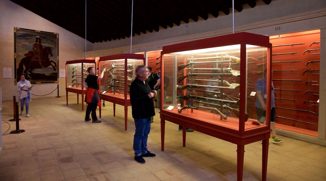 Ronda Bullring Museum featuring interior views as well as a small group of people