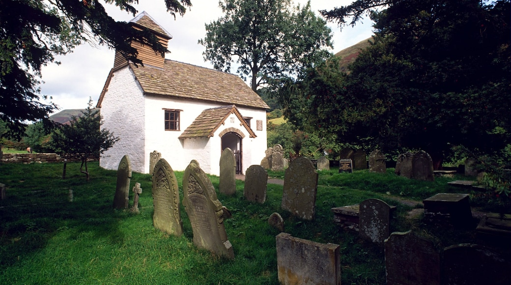 Powys showing a cemetery and a house