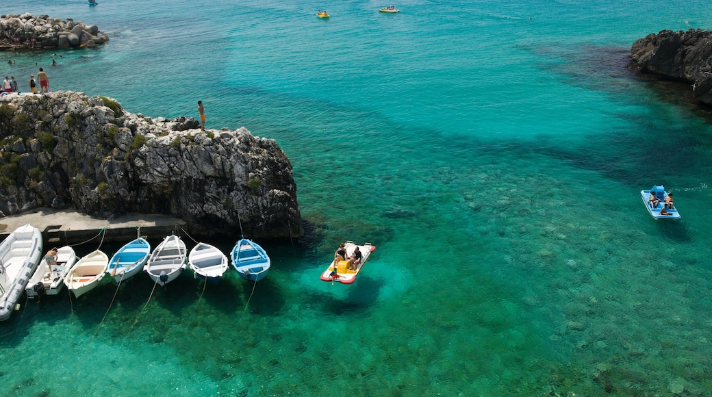 Puglia showing general coastal views, a marina and kayaking or canoeing