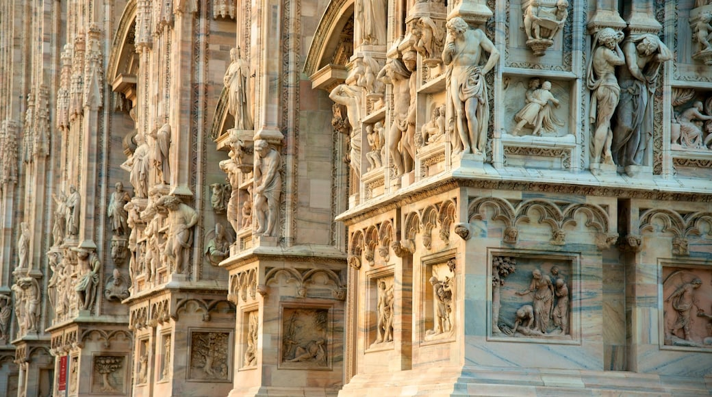 Cathedral of Milan which includes a statue or sculpture, a church or cathedral and heritage architecture