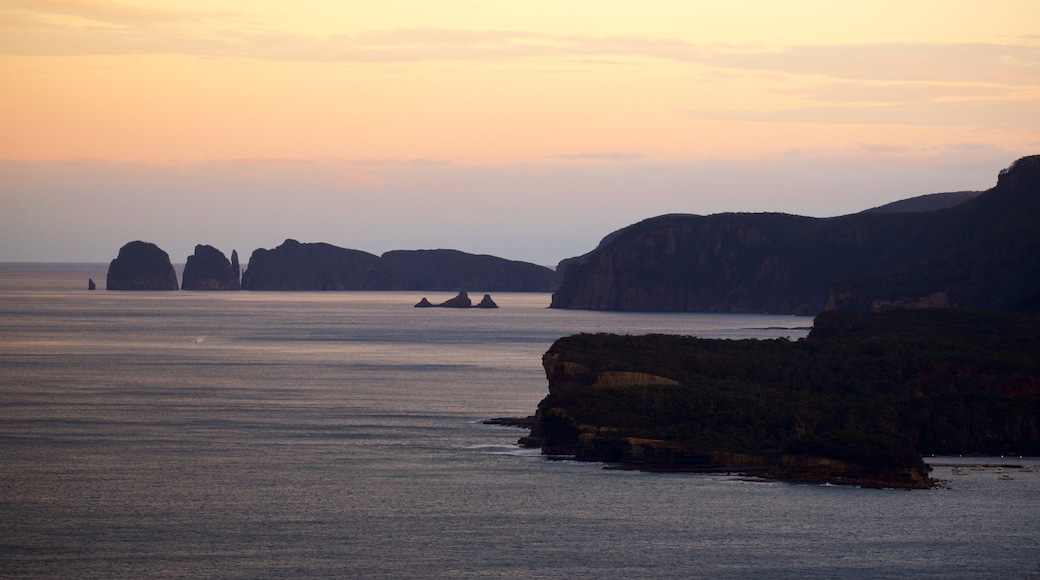 Tasman Peninsula showing rocky coastline and a sunset