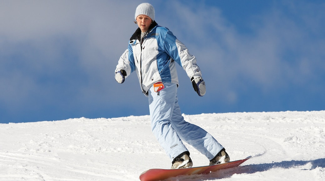 Grayling which includes snow skiing and snow as well as an individual femail