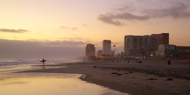 Rosarito which includes general coastal views, a sunset and a beach