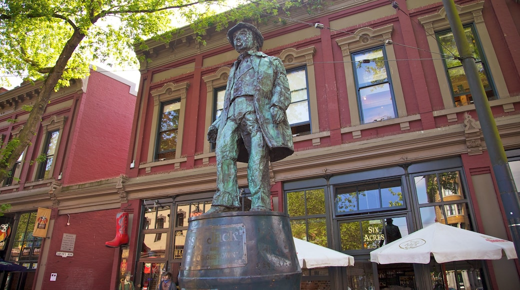 Gastown featuring a statue or sculpture, a monument and a city