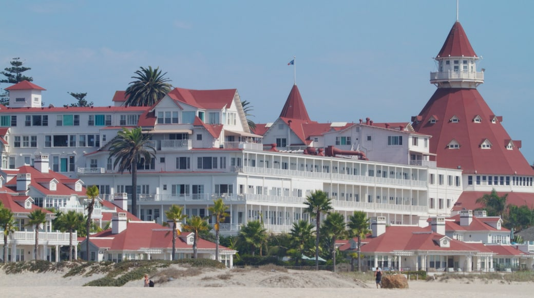 Coronado Beach which includes a beach, a luxury hotel or resort and a city