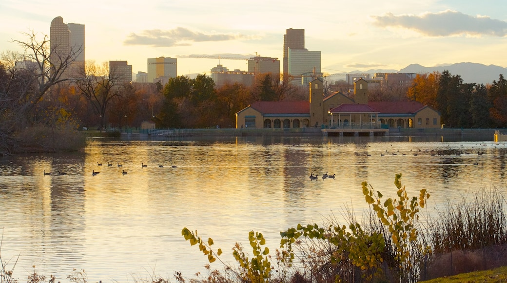 Denver featuring a lake or waterhole, landscape views and a skyscraper