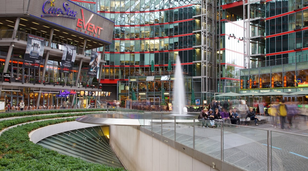 Berlin featuring a fountain, a city and modern architecture