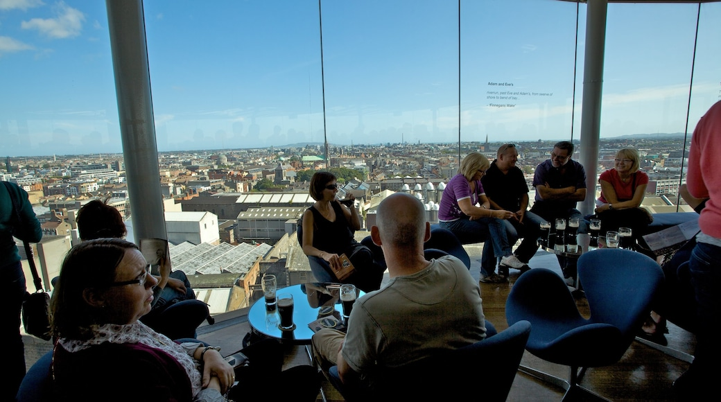 Guinness Storehouse showing interior views, a city and drinks or beverages