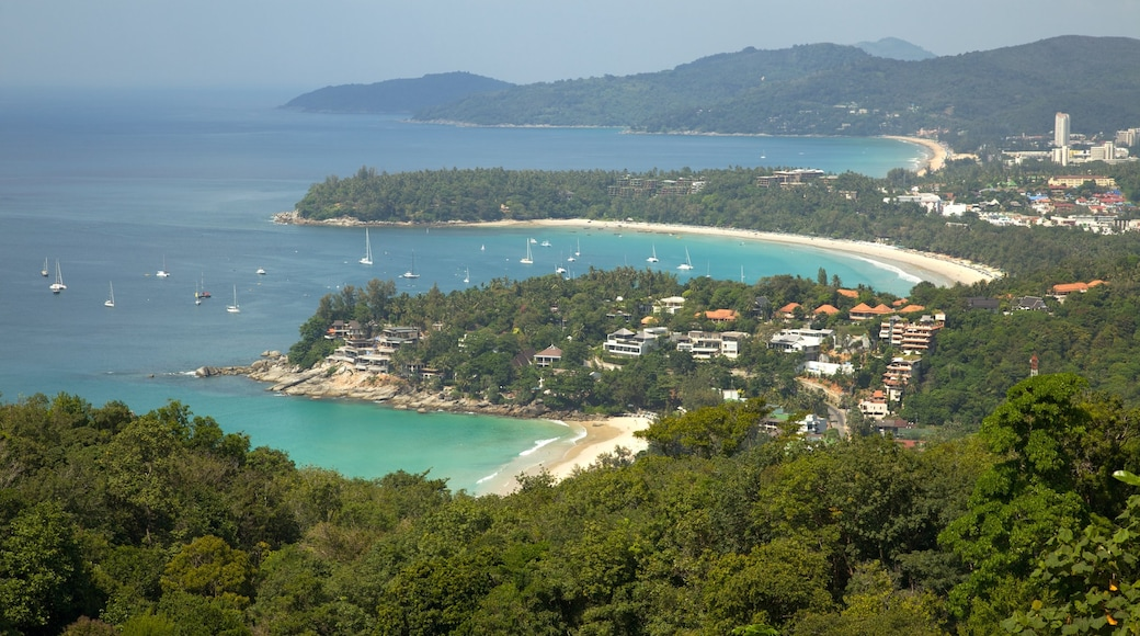 Patong which includes a coastal town, tropical scenes and a bay or harbour