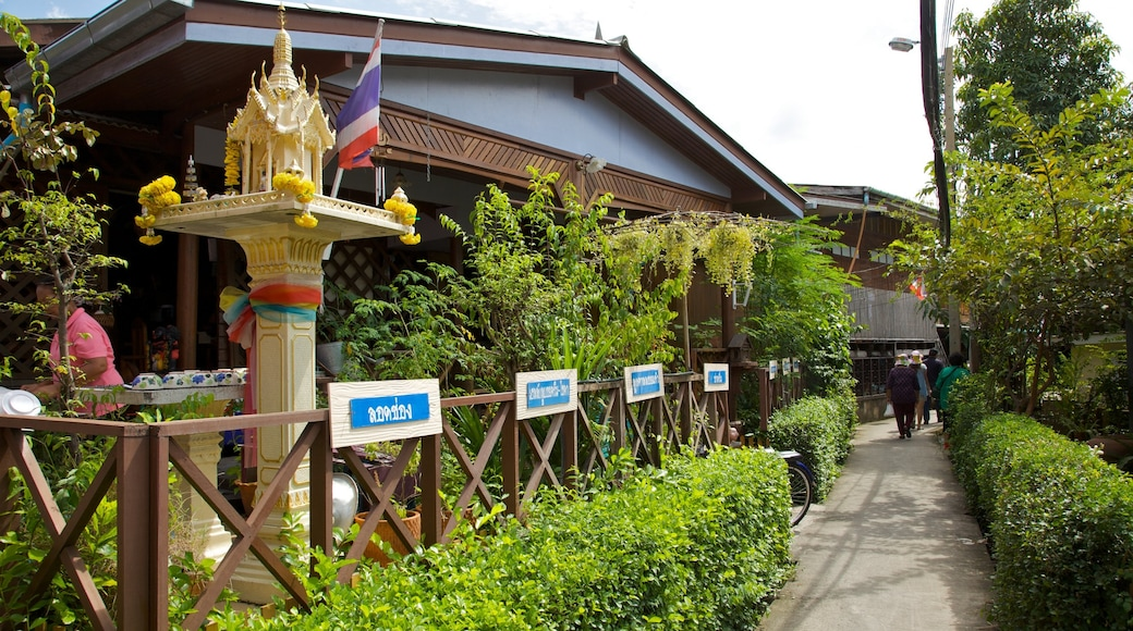 Koh Kret which includes landscape views, a park and a temple or place of worship