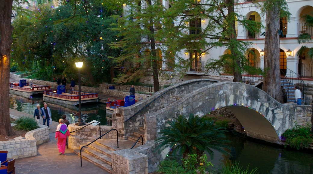 San Antonio featuring a bridge, a pond and a garden