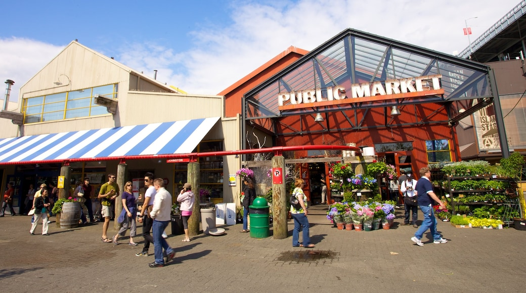 Granville Island Public Market featuring a city, signage and markets