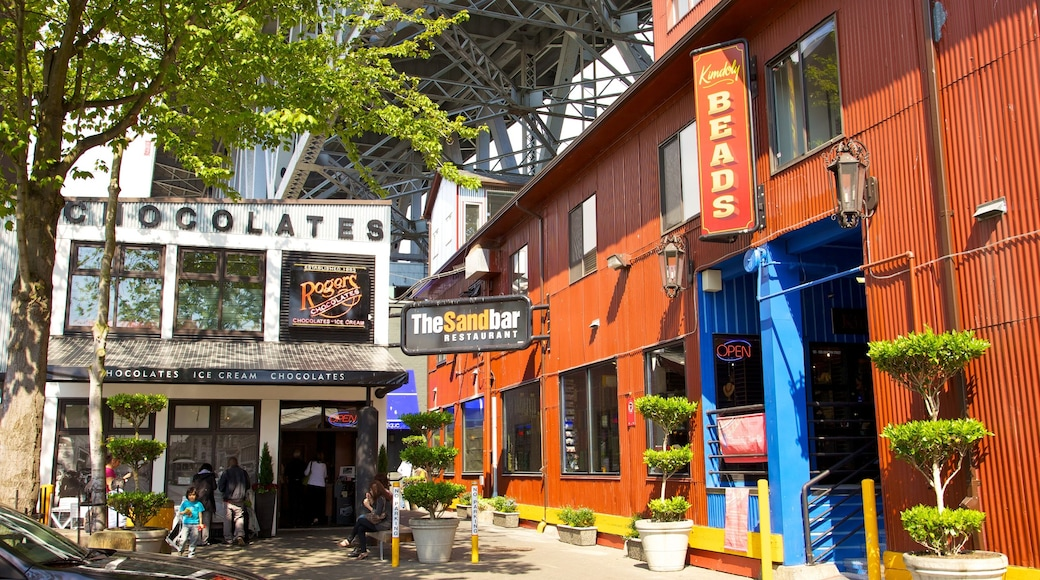 Granville Island Public Market which includes signage, street scenes and markets