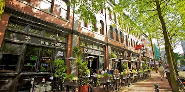Gastown which includes street scenes, café lifestyle and a city