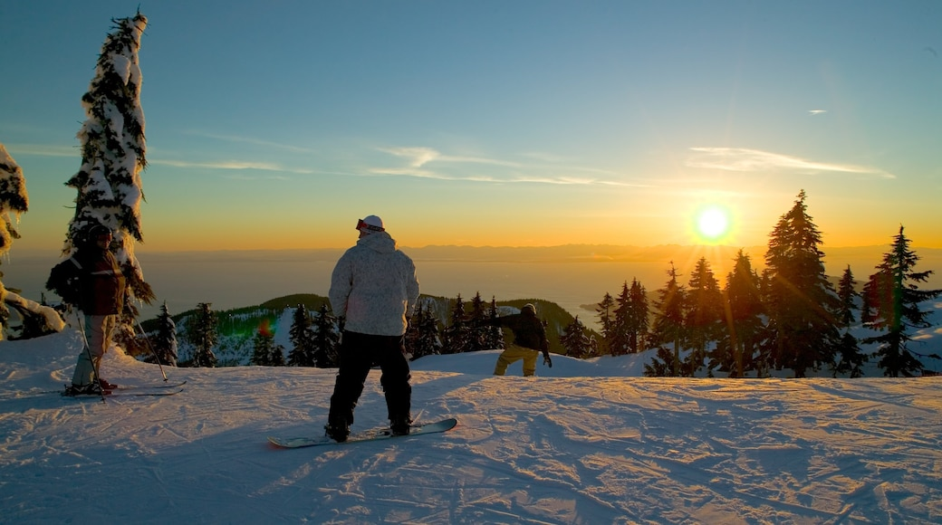 Cypress Mountain featuring mountains, a sunset and snowboarding