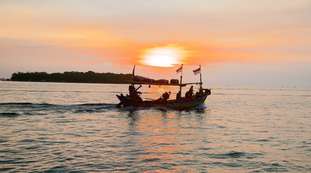 Kepulauan Seribu National Park which includes general coastal views, a sunset and boating