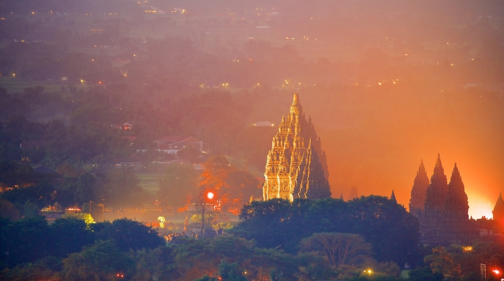 Prambanan Temple which includes landscape views, heritage architecture and mist or fog