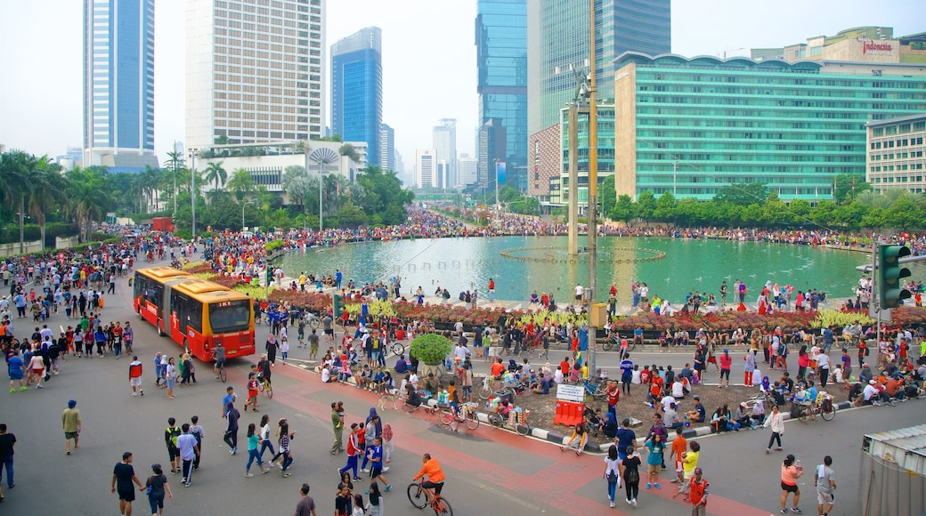 Bundaran Hi showing a square or plaza, a city and a fountain