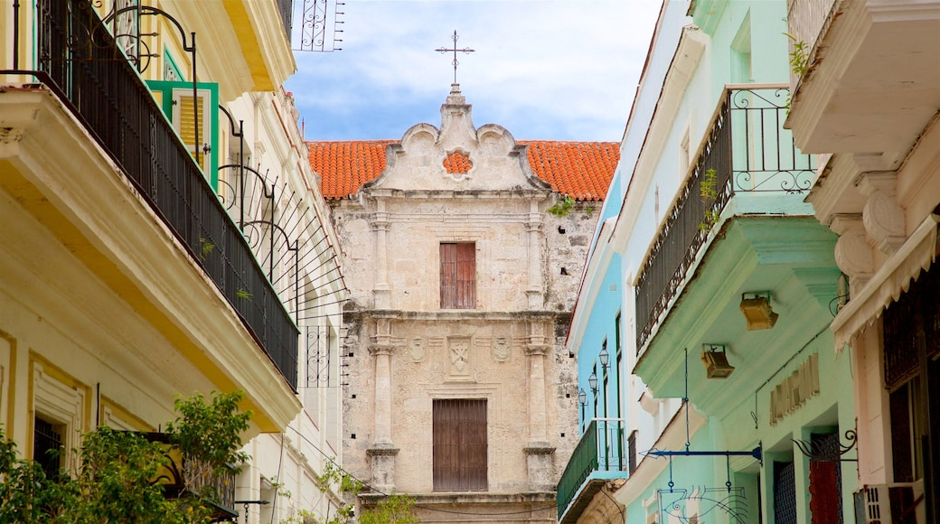 Old Havana featuring a church or cathedral and heritage elements