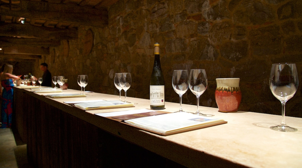 Castello di Amorosa featuring interior views and drinks or beverages