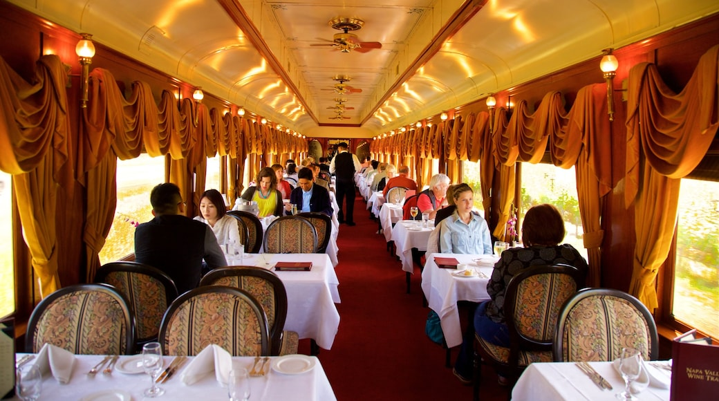 Napa Valley Wine Train which includes dining out and interior views as well as a small group of people