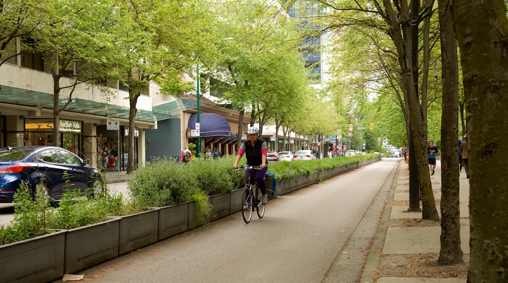 Downtown Vancouver featuring a garden and cycling as well as an individual male