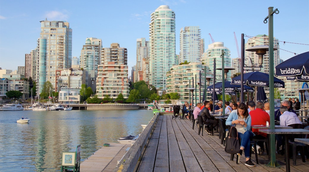 Granville Island showing a bay or harbor, outdoor eating and a city