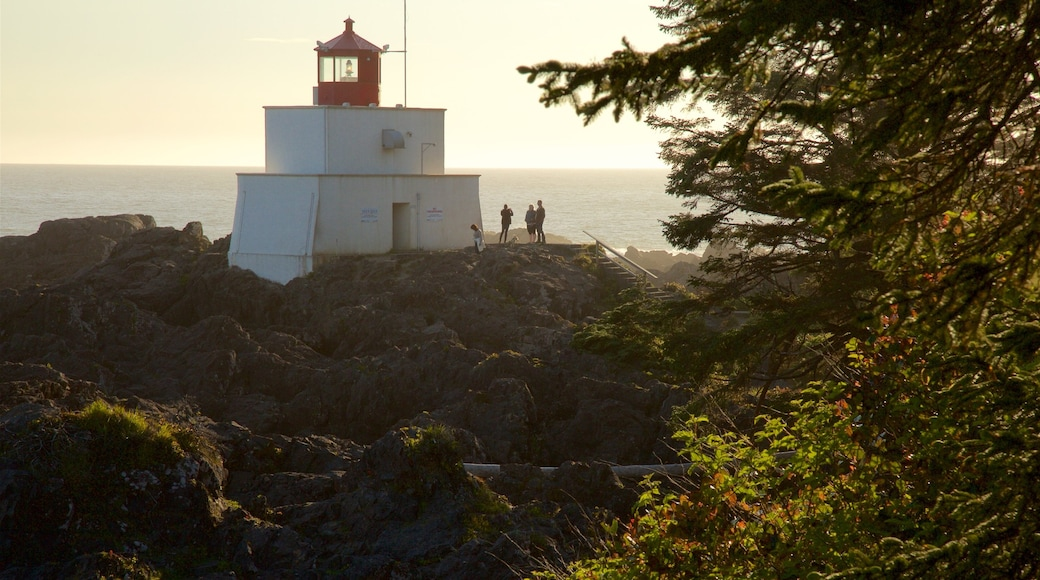 Amphitrite Point Lighthouse featuring a lighthouse, general coastal views and a sunset
