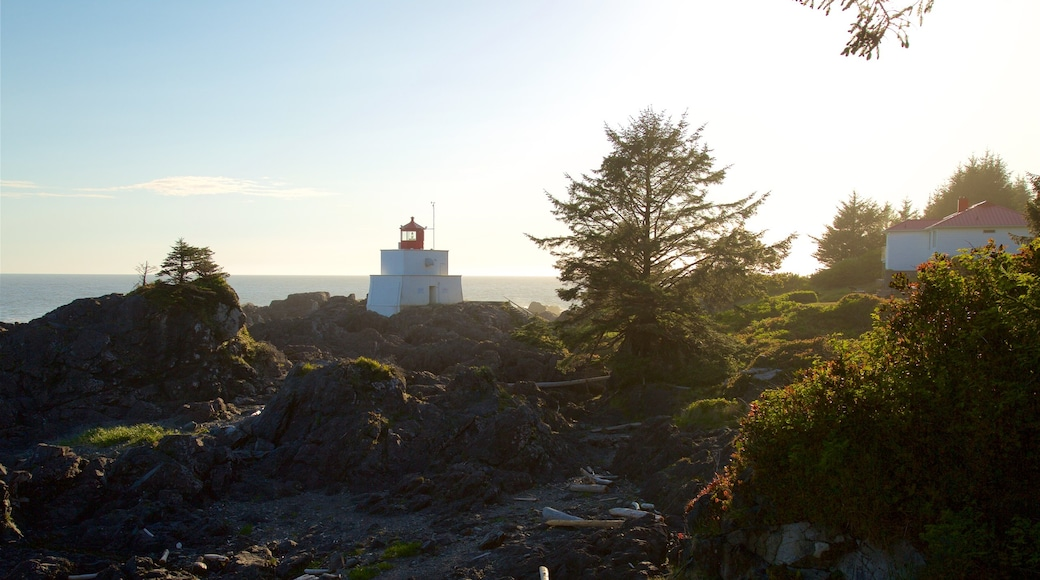 Amphitrite Point Lighthouse showing a sunset, rugged coastline and a lighthouse