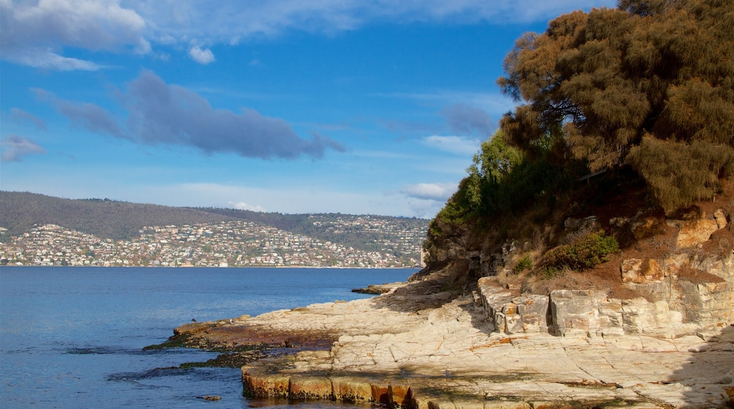 Bellerive which includes tranquil scenes, a river or creek and rocky coastline