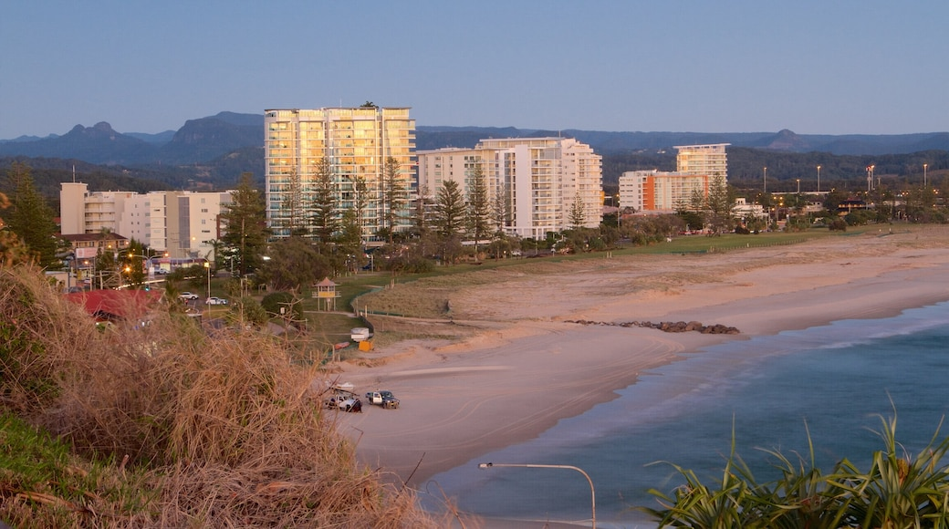 Coolangatta which includes a sandy beach, a sunset and a coastal town
