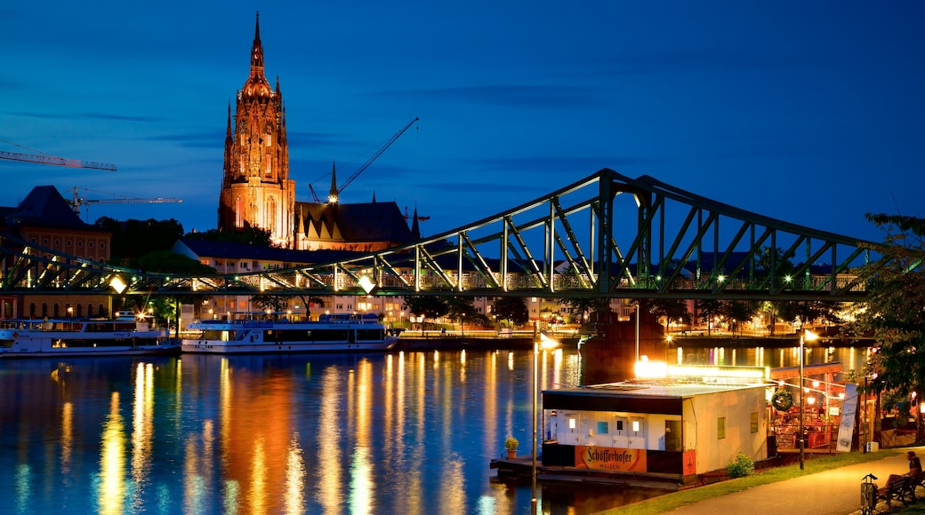 Frankfurt Cathedral featuring heritage elements, night scenes and a river or creek